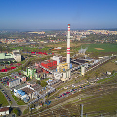 Aerial view of heating plant and thermal power station. Combined modern power station for city district heating and generating electrical power. Industrial zone from above.