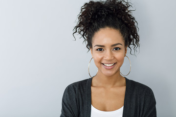 Close up portrait of smiling woman against gray background