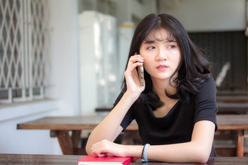 Portrait of thai vietnam teen beautiful girl calling smart phone