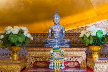 Ancient Buddha statue in Wat Pho church, Bangkok, Thailand