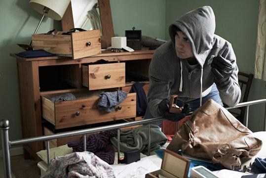 Burglar Stealing Items From Bedroom During Hose Break In