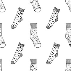 Decorative doodle socks. Black and white seamless pattern for coloring book, pages