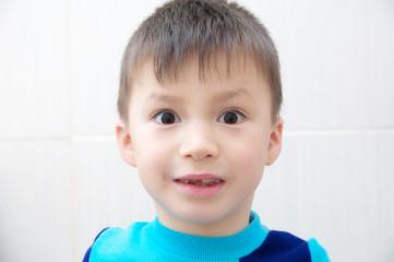 Amazed boy face, surprised child portrait