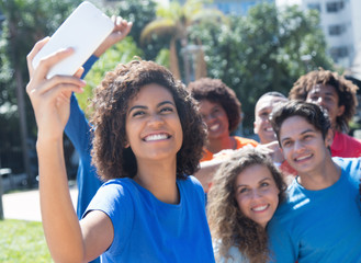 Large group of multiethnic man and woman taking selfie
