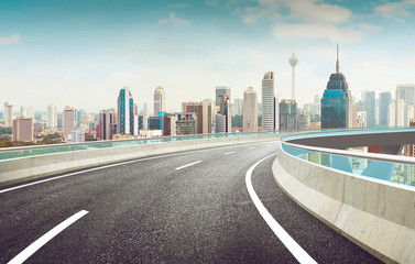 Highway overpass modern city skyline background . Day time scene .