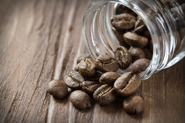 Cofee beans pulled out of glass jar
