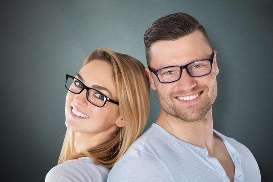Happy Couple With Stylish Eyeglasses