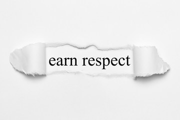 earn respect on white torn paper