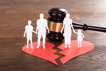 Family Paper Cut On Broken Heart With A Gavel