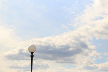 Lonely lamppost against the sky and clouds