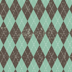 Argyle seamless aged pattern. Blue and brown rhombus, grungy texture. Grunge vintage seamless background.