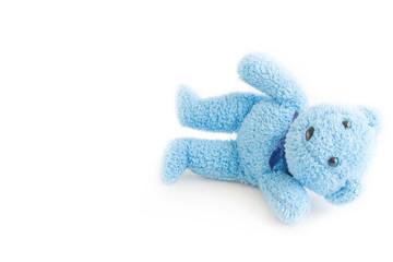 Cute blue teddy bear on white fabric background