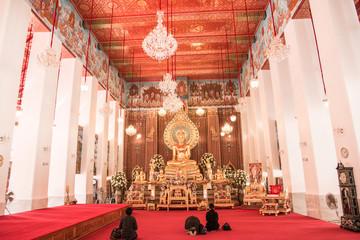 Buddhist faithful inside Wat Chanasongkhram Ratchaworamahawihan (Wat Chana Songkhram), Bangkok