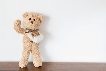 Teddy bear with trauma of the bandaged arm