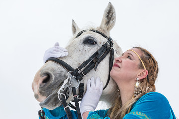 Woman in national dress and horse