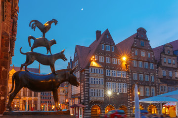 Famous statue of The Bremen Town Musicians, donkey, dog, cat and cockerel, from Grimm's famous fairy tale in the center of Old Town near Bremen City Hall, Bremen, Germany