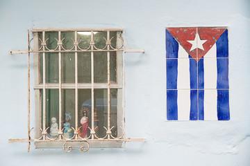 cuban flag on the wall near a window
