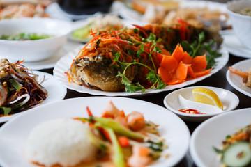 Vietnamese restaurant menu.Tasty fried carp fish & salad