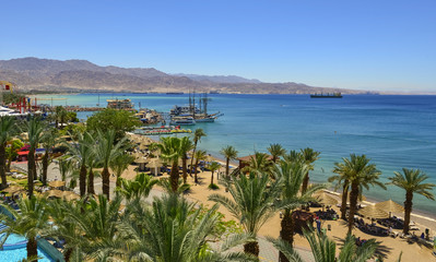 Central public beach of Eilat - number one resort and recreational city in Israel located on the Red Sea