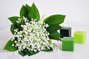 Photo sur Plexiglas Muguet de mai Lily of the valley and the candles