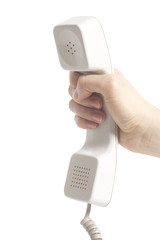 Hand holding white telephone tube