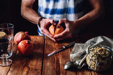 Man Opens Pomegranate.