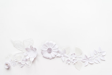 frame with white paper flowers
