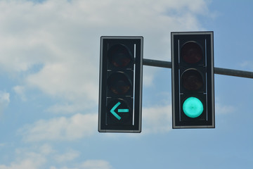 Green  color on the traffic light with blue sky in background