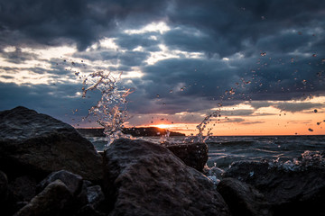 Splashing water on the sunset background