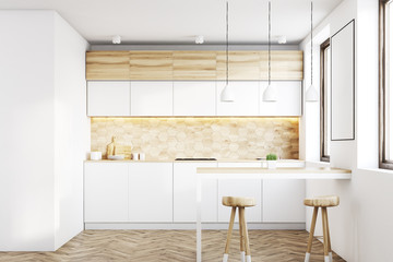 Light wood kitchen with a bar