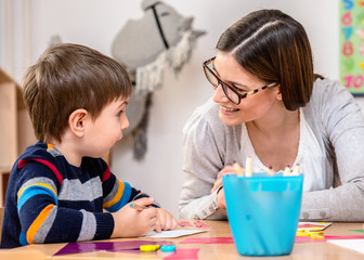 Mother with creative son having fun time together