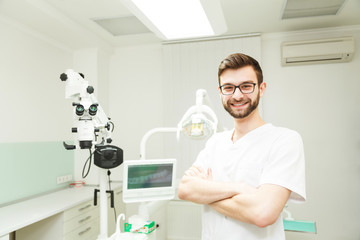 Bearded male dentist in his office