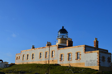 Beautiful Blue Skies Behind Neist Point Lighthouse in Scotland