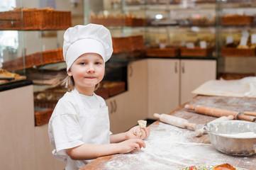 Portrait of a little chef cooking boy