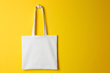 Textile bag on yellow background