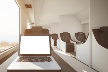 White laptop on train