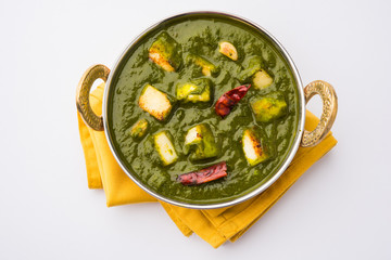 Indian curry dish - Palak paneer made up of  spinach and cottage cheese, served in ceramic bowl, selective focus