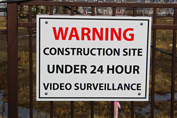 Close up of a construction site surveillance sign