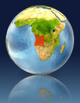 Angola on globe with reflection