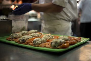 Close up of chef preparing fish in a restaurant.  Seafood in the food and service industry.