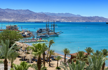 Central public beach in Eilat - number one resort and recreational city in Israel located on the Red Sea