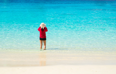 Traveler take a photo of blue sea at beach in sunny day,Summer Vacation concept