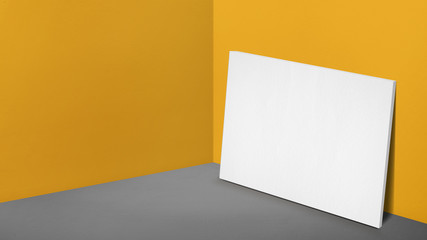 Blank white poster canvas leaning at corner in perspective yellow studio room,Mockup template for adding or display of product or design(3d rendering)