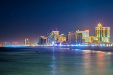 The skyline and Atlantic Ocean at night, in Atlantic City, New Jersey.