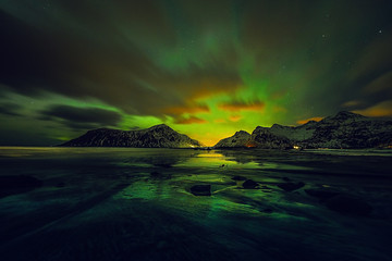 Amazing multicolored green Aurora Borealis also know as Northern Lights in the night sky over Lofoten landscape, Norway, Scandinavia.
