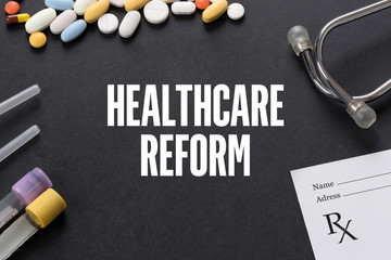 HEALTHCARE REFORM written on black background with medication