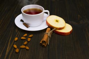 Hot tea with cinnamon and apple