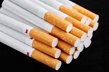 cigarette close up isolated on blak background. Drug addiction. Tobacco smoking. cancer. Nicotine. Bad habit.