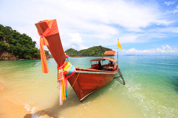 tropical holidays - amazing beaches with Longtail boat at famous sunny Long Beach, Krabi Thailand, Andaman sea