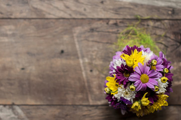 A bouquet of chrysanthemums on woody background